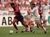 Patrick Kluivert (Barcelona) and Roberto Baronio (Lazio). Barcelona v Lazio. The Amsterdam Tournament. Amsterdam Arena, 5/8/2000. Credit: Colorsport / Stuart MacFarlane.