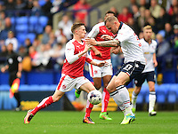Fleetwood Town's Ashley Hunter is tackled by Bolton Wanderers's David Wheater<br /> <br /> Photographer Chris Vaughan/CameraSport<br /> <br /> Football - The EFL Sky Bet League One - Bolton Wanderers v Fleetwood Town - Saturday 20 August 2016 - Macron Stadium - Bolton<br /> <br /> World Copyright © 2016 CameraSport. All rights reserved. 43 Linden Ave. Countesthorpe. Leicester. England. LE8 5PG - Tel: +44 (0) 116 277 4147 - admin@camerasport.com - www.camerasport.com