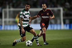September 27, 2017 - Lisbon, Portugal - Sporting's defender Cristiano Piccini (L) vies for the ball with Barcelona's defender Jordi Alba (R)  during  the Champions League 2017/18 match between Sporting CP vs FC Barcelona, in Lisbon, on September 27, 2017. (Credit Image: © Carlos Palma/NurPhoto via ZUMA Press)