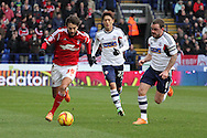 Nottingham Forest's Djamel Abdoun (l) breaks past Bolton Wanderer's captain Jay Spearing. Skybet championship match, Bolton Wanderers v Nottingham Forest at the Reebok Stadium in Bolton, England on Saturday 11th Jan 2014.<br /> pic by David Richards, Andrew Orchard sports photography.