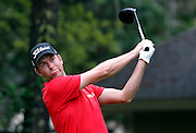 Webb Simpson react to his drive off the eighth tee during the third round of the RBC Heritage golf tournament in Hilton Head Island, S.C., Saturday, April 18, 2015. (AP Photo/Stephen B. Morton)