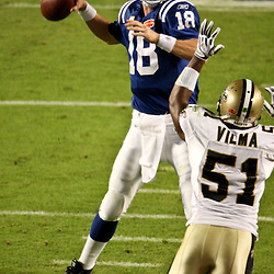 2010 February 07: Indianapolis Colts quarterback Peyton Manning (18) throws a pass as New Orleans Saints linebacker Jonathan Vilma (51) provides pressure during a 31-17 win by the New Orleans Saints over the Indianapolis Colts in Super Bowl XLIV at Sun Life Stadium in Miami, Florida.