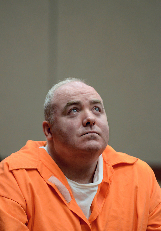 Michael Skakel looks up while listening to a statement from John Moxley, brother of victim Martha Moxley in court in Middletown, Conn., Tuesday, Jan. 24, 2012.  Skakel is seeking a reduction in his sentence of 20 years to life in prison for killing his neighbor Martha Moxley. (AP Photo/Jessica Hill, Pool)