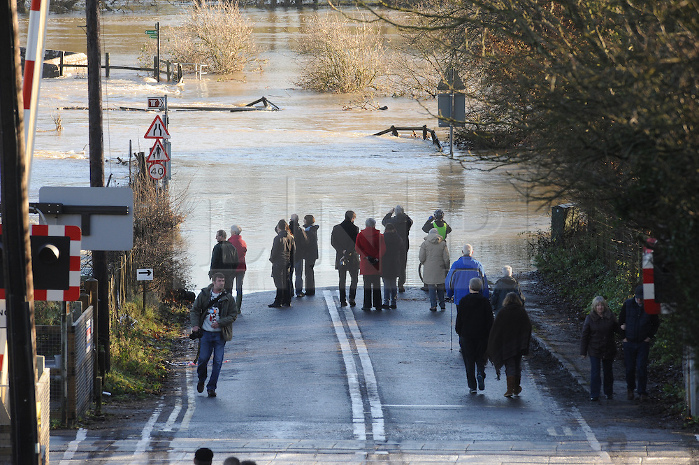 © Licensed to London News Pictures. 26/12/2013<br /> Boxing day flood watchers at Teston,Kent<br /> Teston Bridge near Teston Level Crossing is badly flooded due to the River Medway bursting its banks.<br /> Boxing day flooding in Kent.<br /> Large parts of Kent are still flooded due to heavy rain with more bad weather expected.<br /> Photo credit :Grant Falvey/LNP