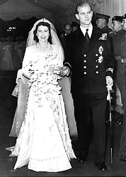 File photo dated 20/11/1947 of Queen Elizabeth II alongside the Duke of Edinburgh as they leave Westminster Abbey after their marriage ceremony. The Queen is wearing the same tiara that was worn by Princess Beatrice at her wedding to Edoardo Mapelli Mozzi on Friday.