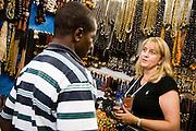 A profesional buyer discusses with a vendor at the 22nd Salon International de l'Artisanat de Ouagadougou (SIAO) in Ouagadougou, Burkina Faso on Sunday November 2, 2008.