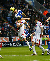 Photo: Steve Bond/Richard Lane Photography. Leicester City v Crystal Palace. E.ON FA Cup Third Round. 03/01/2009. Steve Howard (upper) gets a header in above Jose Fonte (lower)
