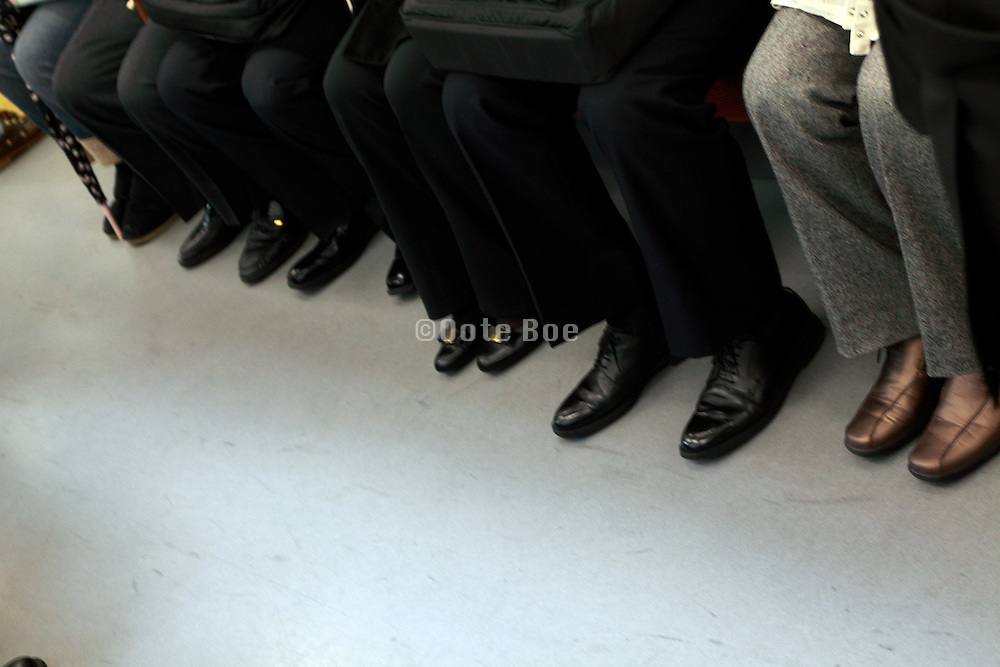 feet of business commuters Tokyo Japan