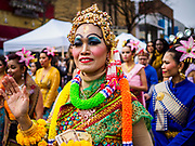 """29 APRIL 2017 - MINNEAPOLIS, MINNESOTA: People in traditional Thai outfits participate in Songkran Uptown parade. Several thousand people attended Songkran Uptown on Hennepin Ave in Minneapolis for the city's first celebration of Songkran, the traditional Thai New Year. Events included a Thai parade, a performance of the Ramakien (the Thai version of the Indian Ramayana), a """"Ladyboy"""" (drag queen) show, and Thai street food.     PHOTO BY JACK KURTZ"""