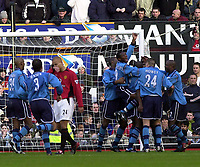 Photo: Greig Cowie<br />Barclaycard Premiership. Manchester United v Manchester City. 09/02/2002<br />The City players engulf Shaun Goater after his late equaliser