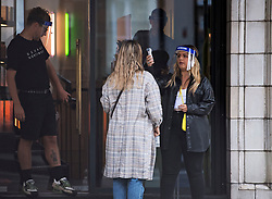 © Licensed to London News Pictures. 04/07/2020. London, UK. A customer has her temperature taken before being allowed to enter George Northwood hair salon in Soho, as barbers and hairdressers are allowed to open for the first time since lockdown. Photo credit: Ben Cawthra/LNP