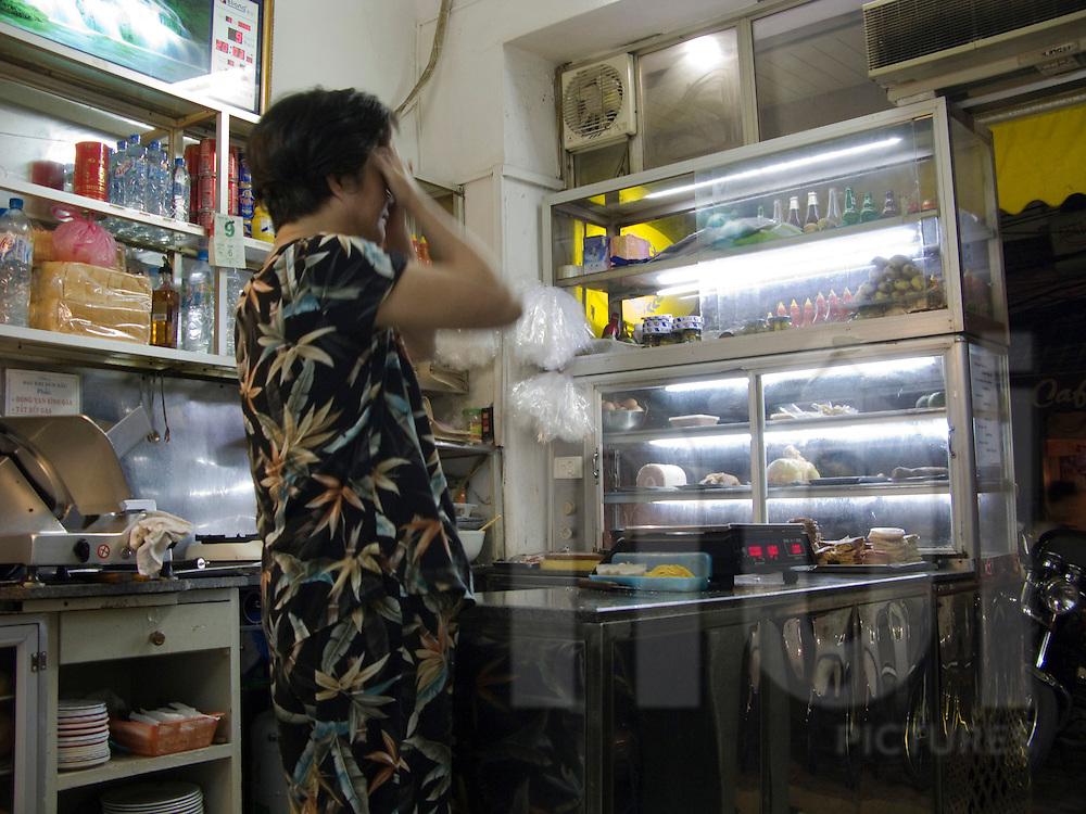 Color film photograph inside 'Nguyen Sinh' butcher shop on Ly Quoc Su Street, Hoan Kiem District, Hanoi, Vietnam, Southeast Asia