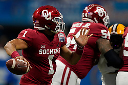 Jalen Hurts #1 of the Oklahoma Sooners throws a pass during the first half against the LSU Tigers in the 2019 College Football Playoff Semifinal at the Chick-fil-A Peach Bowl on Saturday, Dec. 28, in Atlanta. (Paul Abell via Abell Images for the Chick-fil-A Peach Bowl)