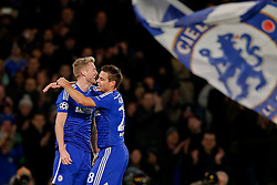 Andre Schurrle of Chelsea celebrates with Cesar Azpilicueta after scoring a goal to make it 2-0 - Photo mandatory by-line: Rogan Thomson/JMP - 07966 386802 - 10/12/2014 - SPORT - FOOTBALL - London, England - Stamford Bridge - Sporting Clube de Portugal - UEFA Champions League Group G.
