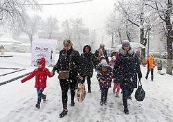 March 27, 2019 - Cherkasy, Ukraine - Women and children struggle through heavy snowfall, Cherkasy, central Ukraine, March 27, 2019. Ukrinform. (Credit Image: © Yulii Zozulia/Ukrinform via ZUMA Wire)