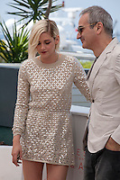 Director Olivier Assayas and actress Kristen Stewart at the Personal Shopper film photo call at the 69th Cannes Film Festival Tuesday 17th May 2016, Cannes, France. Photography: Doreen Kennedy