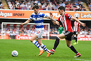 Queens Park Rangers Midfielder Pawel Wszolek (22) and Brentford Defender John Egan (14) battle for the ball during the EFL Sky Bet Championship match between Brentford and Queens Park Rangers at Griffin Park, London, England on 21 April 2018. Picture by Stephen Wright.