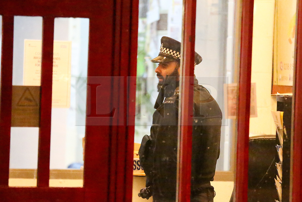© Licensed to London News Pictures. 11/03/2020. London, UK. A police officer inside the Chestnuts Park Community Centre in Chestnuts Park, Haringey, north London after a man was shot around 5pm. Emergency services were called to the centre which is near a children's playground. A man was found at the scene with gunshot wounds and has been taken to a hospital. Photo credit: Dinendra Haria/LNP