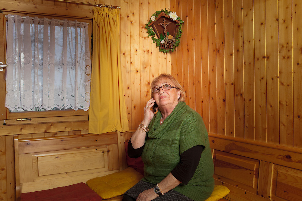 Woman pensioner telephone cell phone crucifix