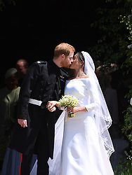 Britain's Prince Harry and Meghan Markle kiss as they exit St George's Chapel in Windsor Castle after their royal wedding ceremony, in Windsor, Britain, 19 May 2018. The couple have been bestowed the royal titles of Duke and Duchess of Sussex on them by the British monarch. Photo by Neil Hall/ABACAPRESS.COM