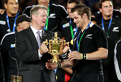 © Andrew Fosker / Seconds Left Images 2011 -  New Zealand's Richie McCaw (Captain) receives Webb Ellis Cup from Bernard Lapasset  (L) France v New Zealand - Rugby World Cup 2011 - Final - Eden Park - Auckland - New Zealand - 23/10/2011 -  All rights reserved..