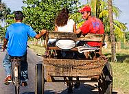Hitching a ride in Ciego de Avila, Cuba.