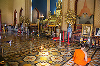 Thai Monks at Wat Benchamabophit  - Wat Benchamabophit Dusitvanaram is also known as the marble temple and one of Bangkok's most beautiful temples typifying the ornate Thai style of gables, step roofs and elaborate details.  Construction of the temple began in 1899 at the request of King Chulalongkorn to be near his palace nearby. A picture of the temple's facade is on the Thai five baht coin.