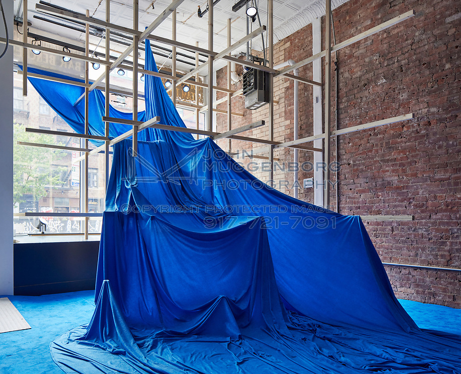 """Alois Kronschlaeger's """"Kind of Blue"""" installation in a vacant storefront below the Cristin Tierney Gallery at 219 Bowery.<br /> <br /> http://www.johnmuggenborg.com"""