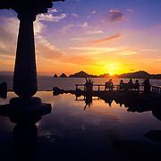 Group of people enjoying a sunset in Da Giorgio restaurant. Cabo San Lucas, Baja California Sur. Mexico.