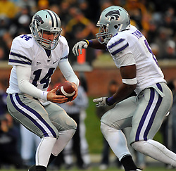 Nov 13, 2010; Columbia, MO, USA; Kansas State Wildcats quarterback Carson Coffman (14) fakes a hand off to running back Daniel Thomas (8) in the second half against the Missouri Tigers at Memorial Stadium. Missouri won 38-28.  Mandatory Credit: Denny Medley-US PRESSWIRE
