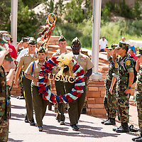 081413        Brian Leddy<br /> Young Marines from around the country hang a wreath at the Navajo Code Talker statue in Window Rock Wednesday.