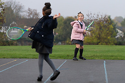 72 POINT. Breakfast club attendees at Chingford Church of England junior School enjoy breakfast and fun and games before school. Chingford, London, November 06 2018.