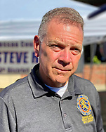 Bellmore, New York, U.S.  September 25, 2021.  New York State Legislator STEVE RHOADS (Republican - 19th District) speaks with visitors at the 34th Annual Bellmore Fmaily Street Festival.