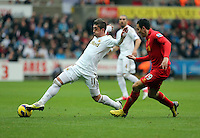 Sunday, 25 November 2012..Pictured L-R: Pablo Hernandez of Swansea against Stewart Downing of Liverpool..Re: Barclays Premier League, Swansea City FC v Liverpool at the Liberty Stadium, south Wales.