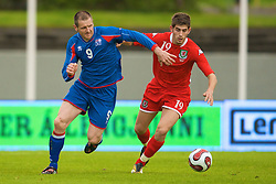 REYKJAVIK, ICELAND - Wednesday, May 28, 2008: Wales' Ched Evans and Iceland's Stefan Thordarson during the international friendly match at the Laugardalsvollur Stadium. (Photo by David Rawcliffe/Propaganda)