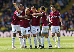 West Ham United's Mark Noble celebrates scoring their first goal his during the Premier League match at Vicarage Road, Watford.