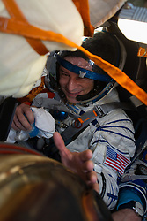 Expedition 62 crew member Andrew Morgan of NASA gives a thumbs up after he, Roscosmos cosmonaut Oleg Skripochka, and NASA astronaut Jessica Meir landed in their Soyuz MS-15 spacecraft in a remote area near the town of Zhezkazgan, Kazakhstan on Friday, April 17, 2020. Meir and Skripochka returned after 205 days in space, and Morgan after 272 days in space. All three served as Expedition 60-61-62 crew members onboard the International Space Station.<br /> <br /> Where: Zhezkazgan, Kazakhstan<br /> When: 17 Apr 2020<br /> Credit: NASA/GCTC/Andrey Shelepin/Cover Images<br /> <br /> **Editorial use only**
