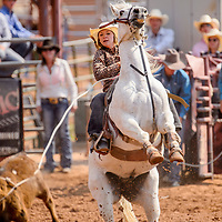 Breakaway roper Jett Parke reins in her horse to pull the slack from the rope in the Best of the Best rodeo Friday at Red Rock Park in Gallup.