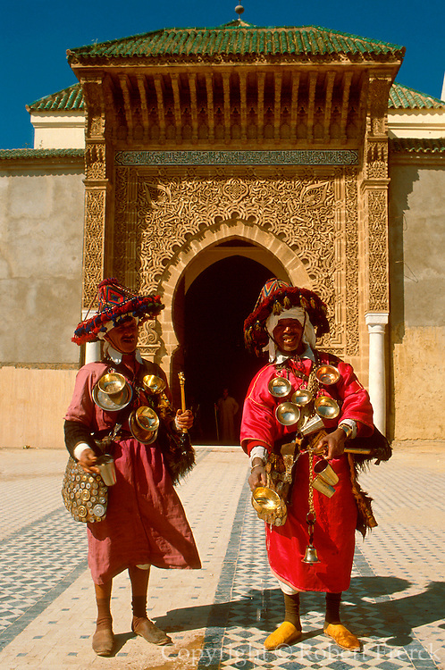 MOROCCO, MEKNES Tomb of Moulay Ismail, who reigned 1672-1727; the entrance doorway with water venders in traditional dress