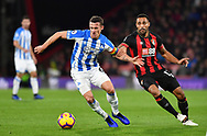 Huddersfield Town midfielder Jonathan Hogg (6) and Callum Wilson (13) of AFC Bournemouth during the Premier League match between Bournemouth and Huddersfield Town at the Vitality Stadium, Bournemouth, England on 4 December 2018.