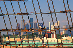 Stock photo of rebar frame awaiting a concrete pour with the downtown Houston skyline in the background.
