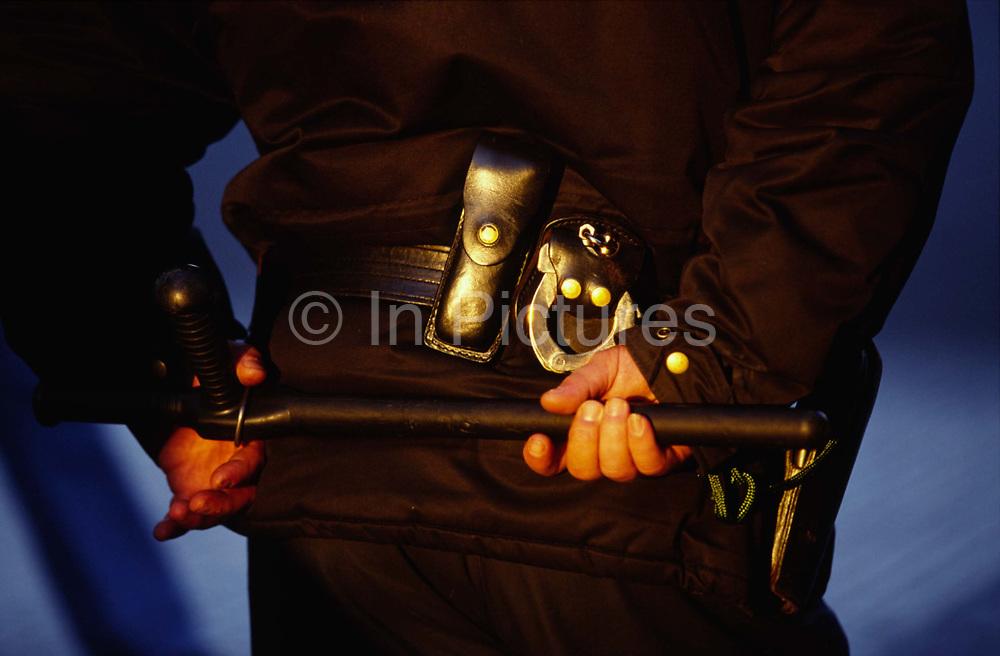 A riot policeman with truncheon. Anti Globalisation riots Prague, Czech Republic