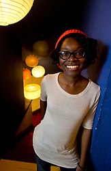 """Echo Brown, an Ivy League-educated journalism-major-turned-acctress, poses for a photograph in her Oakland, Calif. home, Wednesday, June 17, 2015. Brown explores the politics of sex and race in her solo show """"Black Virgins are not for Hipsters,"""" currently running at the Marsh Theater in San Francisco's Mission District. (D. Ross Cameron/Bay Area News Group)"""