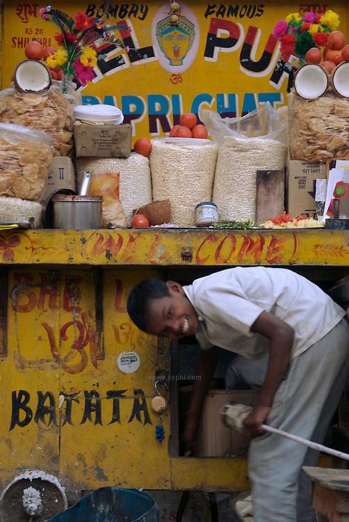 A young boy and a Bhel Puri stall near Victoria memorial, Kolkata January 2007.