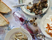 Sardines, escargot and a wine glass. Big lunch on saturday with the Moschonas family. In and around the village of Meronas.