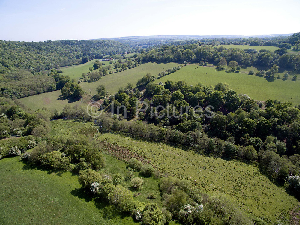 Aerial view of the agricultural landscape near Hawnby village, North York Moors National Park, United Kingdom on 24th May 2018. The North York Moors consist of a moorland plateau, intersected by a number of deep dales or valleys containing cultivated land or woodland