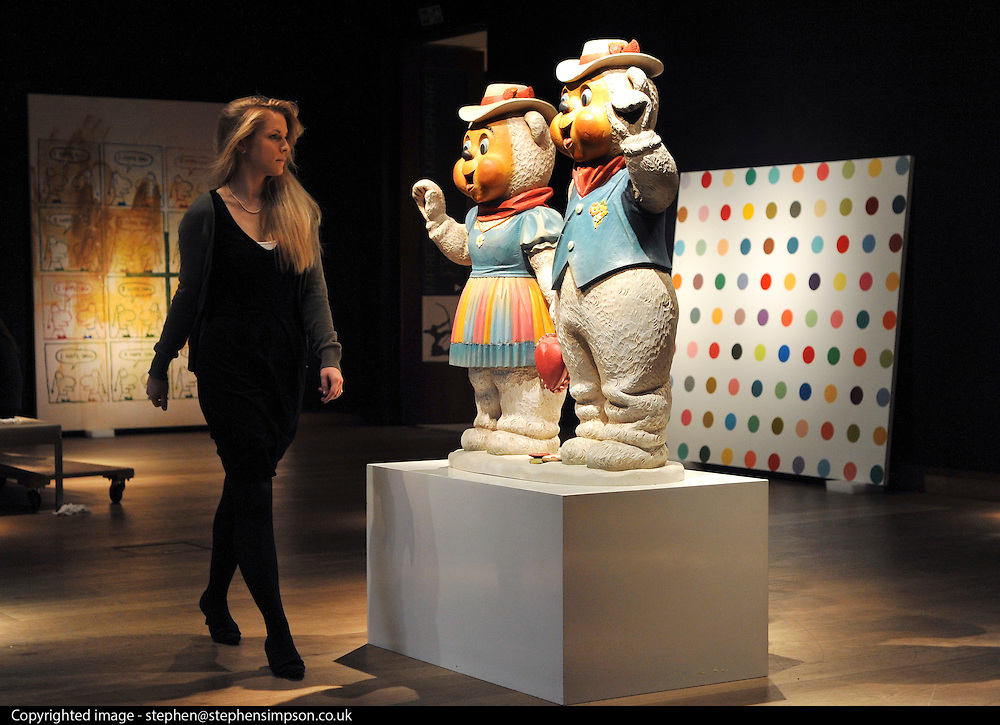 London News pictures. 08.02.2011. A woman walks past a sculpture by Jeff Koons entitled Winter Bears, estimated to fetch 2.5-3.5million at auction.  A preview, today (Fri) of Christie's Auction House Post-War and Contemporary Art Evening Auction. The sale is expected to make a combined total of 46,246,000 to 66,447,000 when it is sold on 16th Feb 2011.. Picture Credit should read Stephen Simpson/LNP
