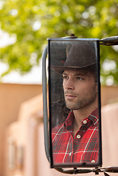 cowboy reflection in a car side mirror