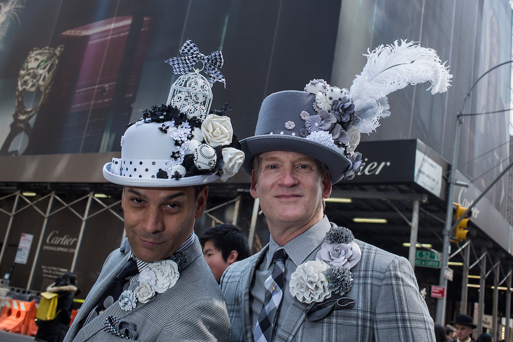 New York, NY, USA-27 March 2016. Two well-dressed men, one in a decorated bowler hat, the other in a plumed top hat, in the annual Easter Bonnet Parade and Festival.