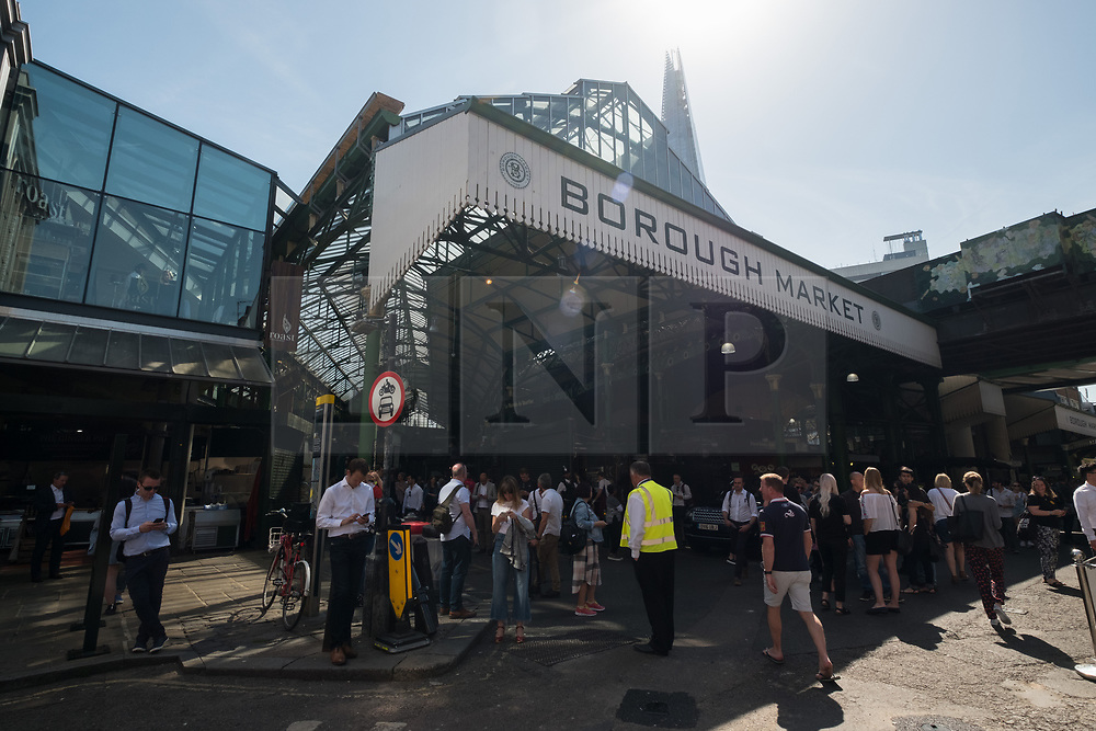 © Licensed to London News Pictures. 14/06/2017. London, UK. Shop owners and stall holders are open for business as Borough Market re-open on the first day of trading after the terrorist attacks 3rd June which left eight people dead and three terrorists shot dead by police. Photo credit: Ray Tang/LNP